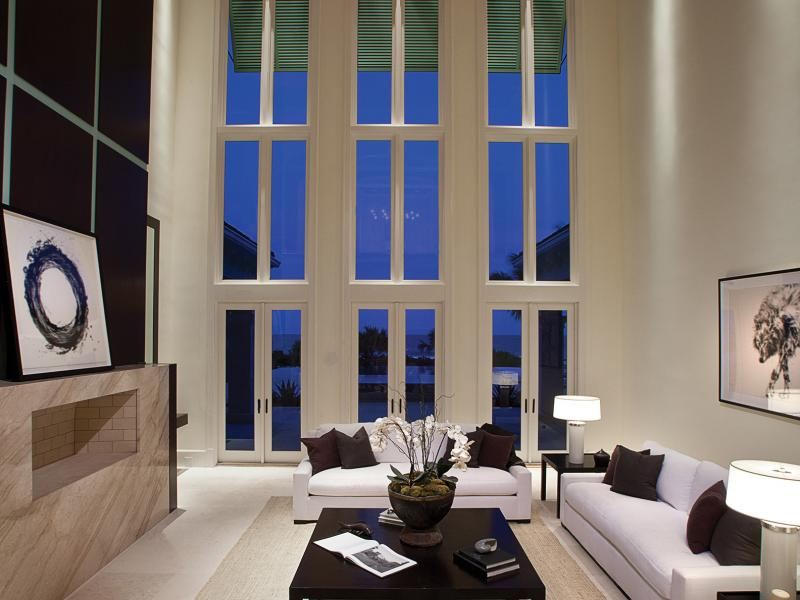Architectural wood clad hurricane impact windows custom home
